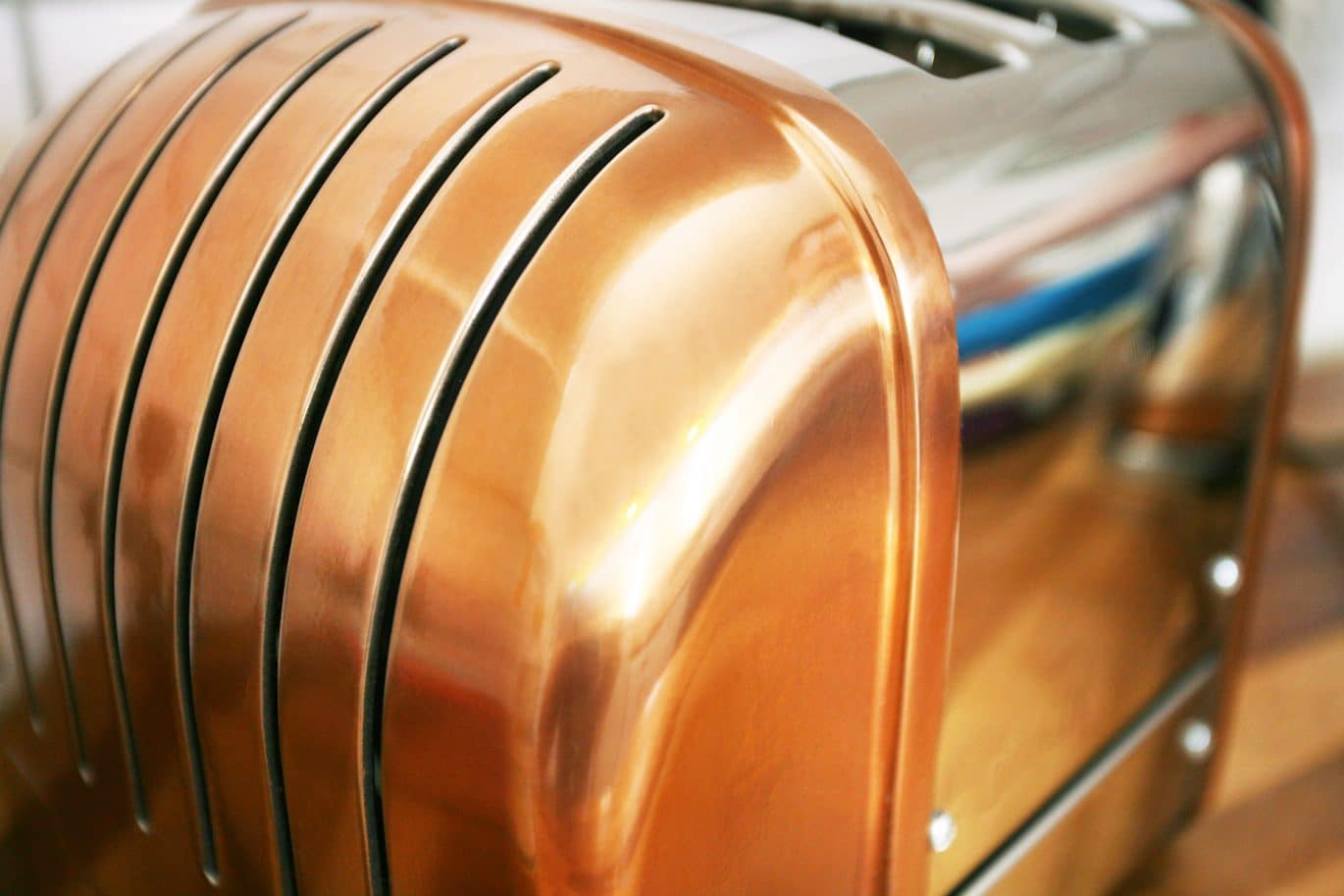 Close up of a clean, shiny cleaning customer's copper coloured toaster